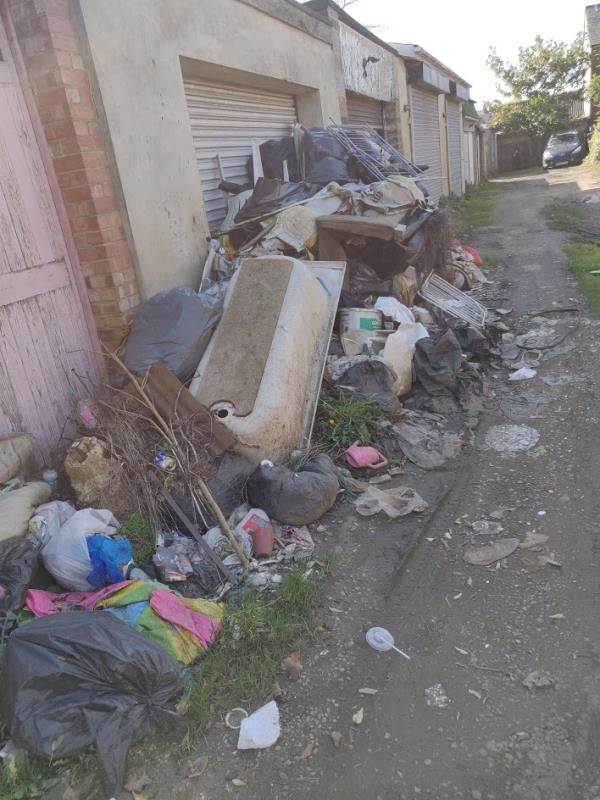 A big rubbish pile dumped on soft ground. Might be a sanitary issue if there are contaminants in the pile. The wind keeps blowing waste from the pile all over the place.  What3words exact location: https://w3w.co/modest.influencing.dreams -49 Charles Street, Reading, RG1 7DB
