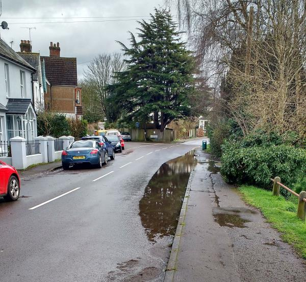 Blocked drain (again) causing flooding over 1/3 of the carriageway width -The Gables Station Road, Steyning, BN44 3YF