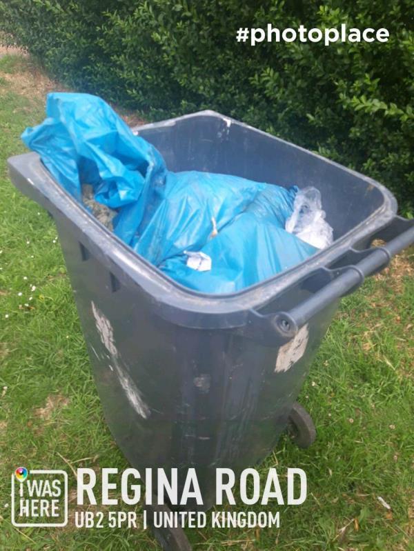 wheelie bin full of sacks containing builders rubble image 1-162 Regina Road, London, UB2 5PR