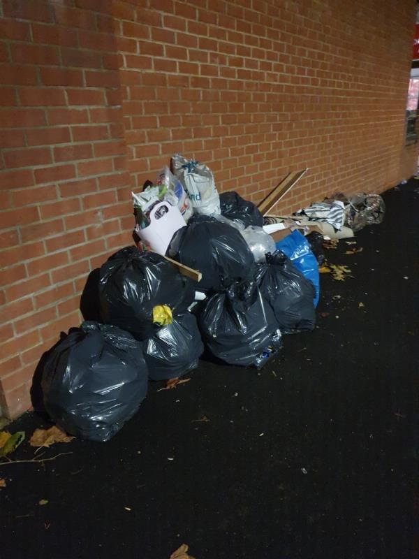 carpet, rubbish bags dumped on pavement -66 Cromwell Road, Upton Park, E7 8PB