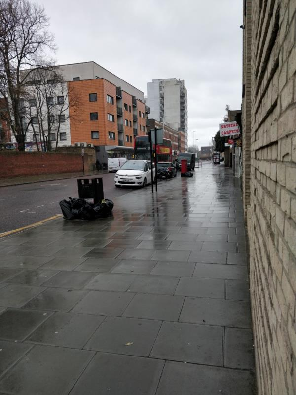 Dumped bags of rubbish on the pavement beside 91 Leytonstone Road E15-Fusion Court, 91-97 Leytonstone Road, London, E15 1HD