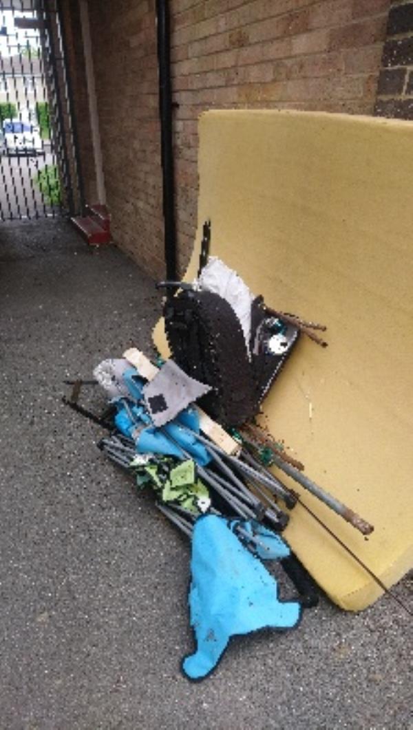 Fly tip through metal gate at 89-141 Stanhope Rd Rothbury Court -110 Denton Court HEXHAM, Reading, RG2 7UB