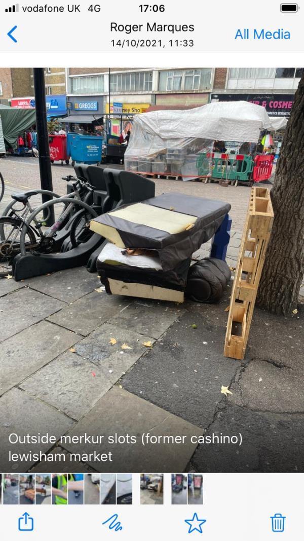 Broken up sofa on lewisham market - at clock end outside Merkur Cashino ( slot machines shop)-110 Lewisham High Street, London, SE13 6AT