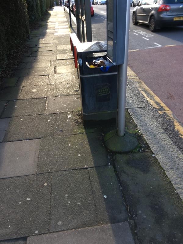 Litter bin full by bus stop GZ Woodfield way on Durnsford Road N11-73 Durnsford Road, London, N11 2EN