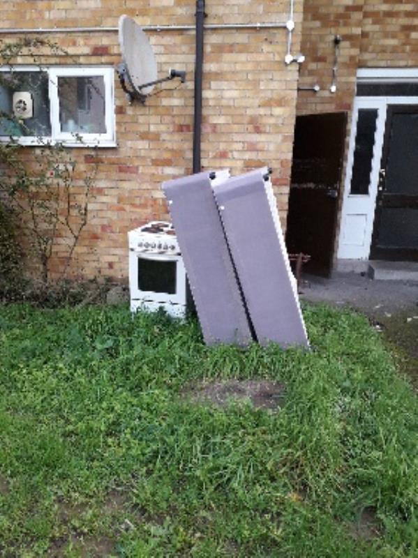 dumped items. rear of 5 Coronation Square.-27 Coronation Square, Reading, RG30 3QP