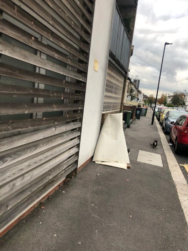 Carpet dumped on the pavement -61c Albert Square, London, E15 1HJ