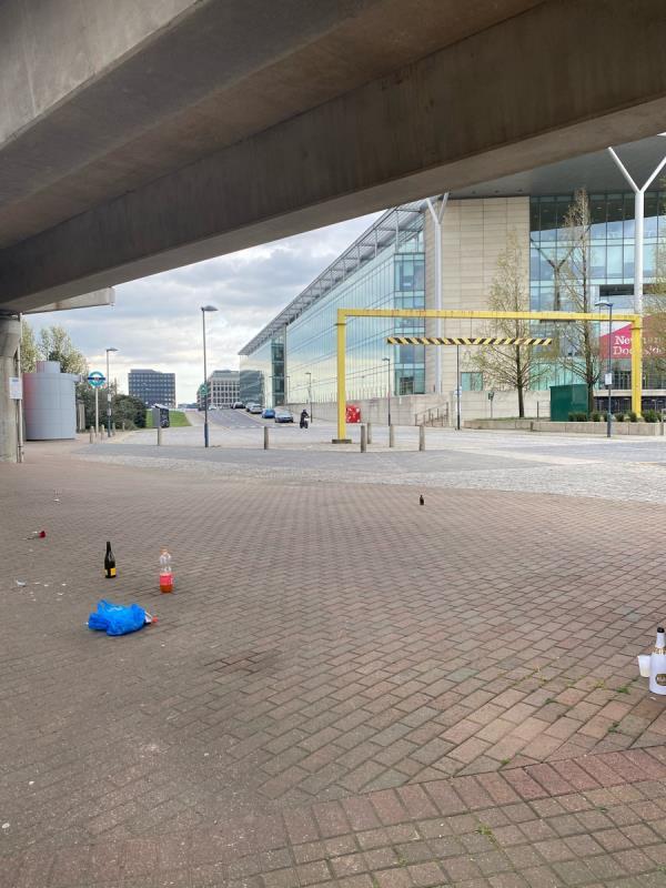Broken bottles, half full drink bottles, etc left by station almost opposite Building 1000 on Dockside. -The Compressor House, 1020 Dockside Road, North Woolwich, E16 2QD