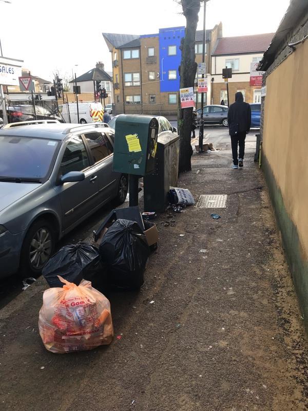 Corner Romford Road/Colchester Avenue E125JT fly-tip including several bin bags, rubbish and a microwave. Please remove  image 2-931e Romford Road, London, E12 5