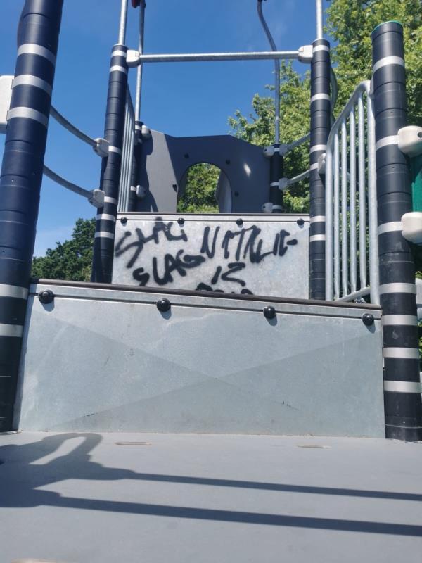 Graffiti on the children's slide and climbing frame on Windsor Avenue playing fields -145 Windsor Avenue, Wolverhampton, WV4 4BJ
