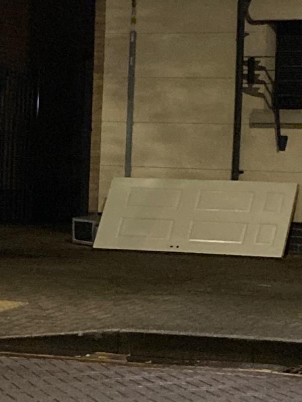 Door and microwave dumped outside Jane Austen Hall-Jane Austen Hall, 21 Munning House, London, E16 1UL