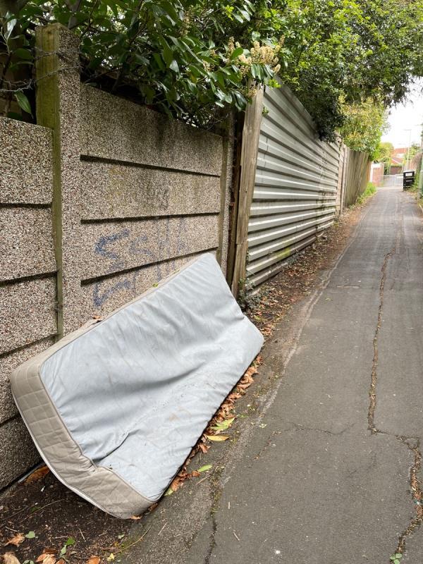Mattress in alley by st Michaels infant school (near top)-85 Coronation Road, Aldershot, GU11 3QA