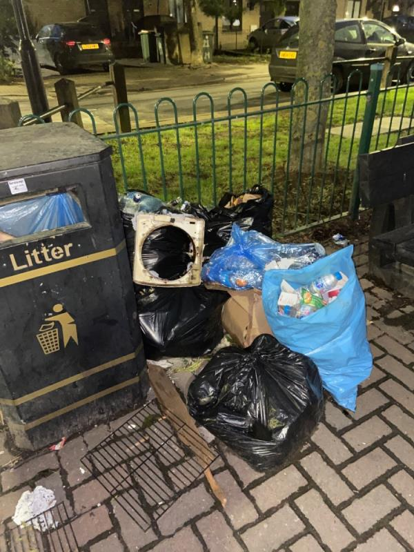 Piles of domestic waste by the bin at the Britannia Village Green play area -27 Hanameel Street, Canning Town, E16 2AR