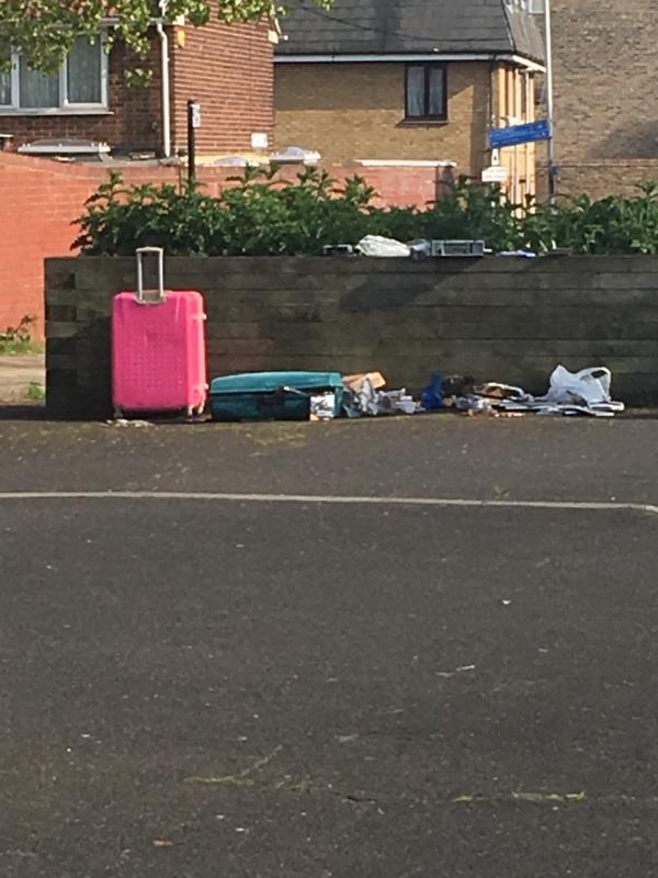 Suitcases of stuff being rummaged through-Mcgrath Road, London E15 1RW, UK