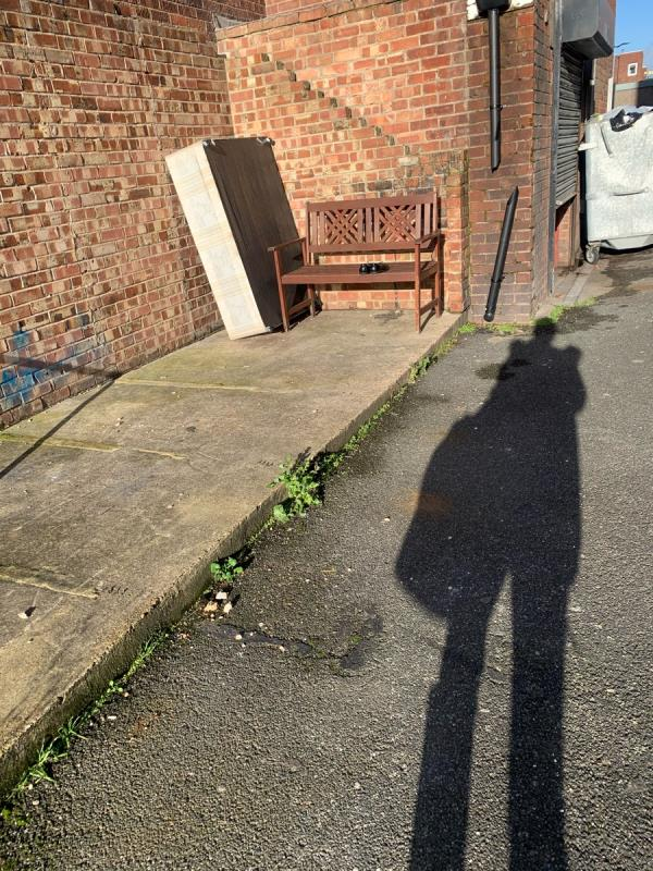 A wooden bench and base of a bed dumped at the back of falcon street needs picking up ASAP -68 Falcon Street, London, E13 8DE