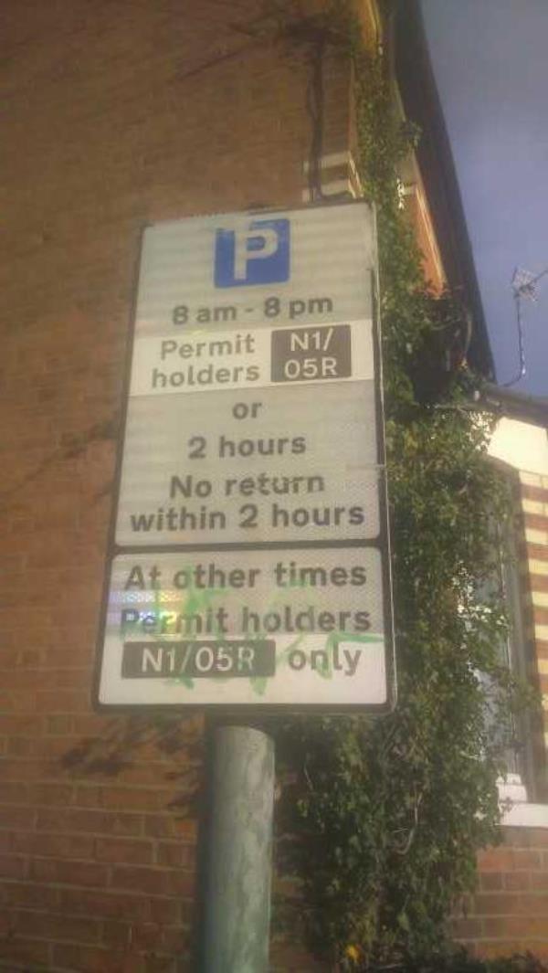graffiti on the sign -44 Battle Street, Reading, RG1 7NU
