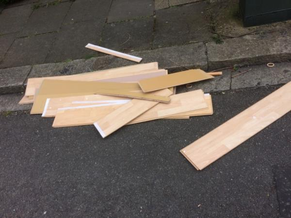 Dumped plywood -48 Beaufort Road, London, W5 3EA