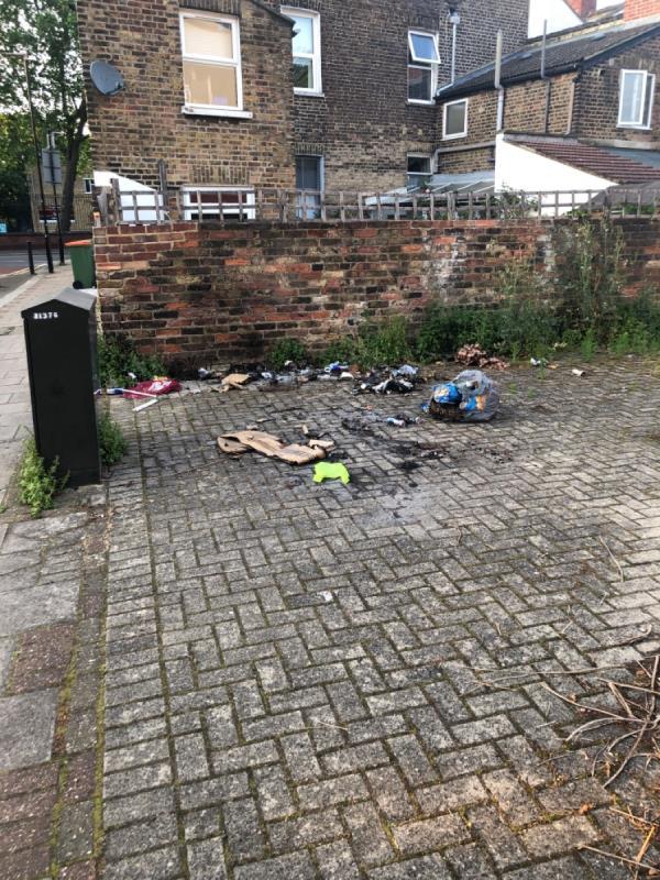 Burnt rubbish-160 Portway, London, E15 3QW