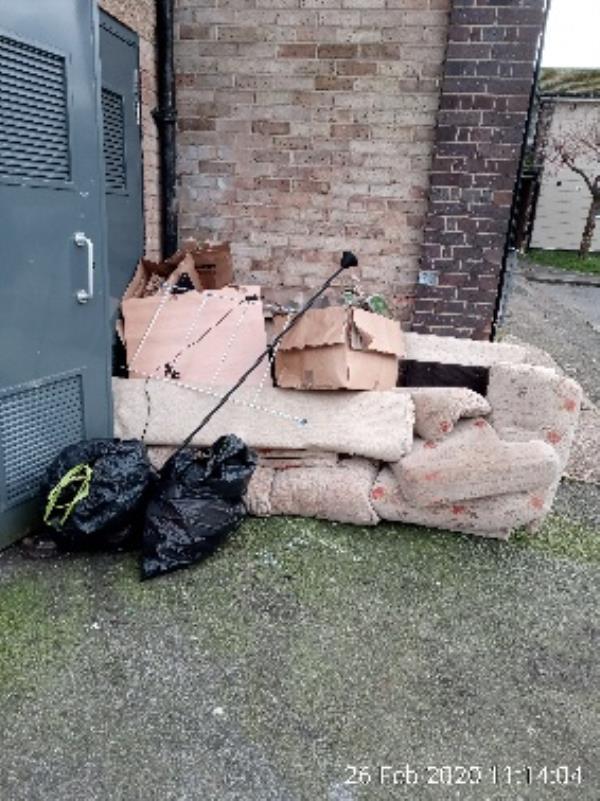Kielder Court, outside if the bin store. Sofa and other random stuff -16 Brent Gardens, Reading, RG2 7SS