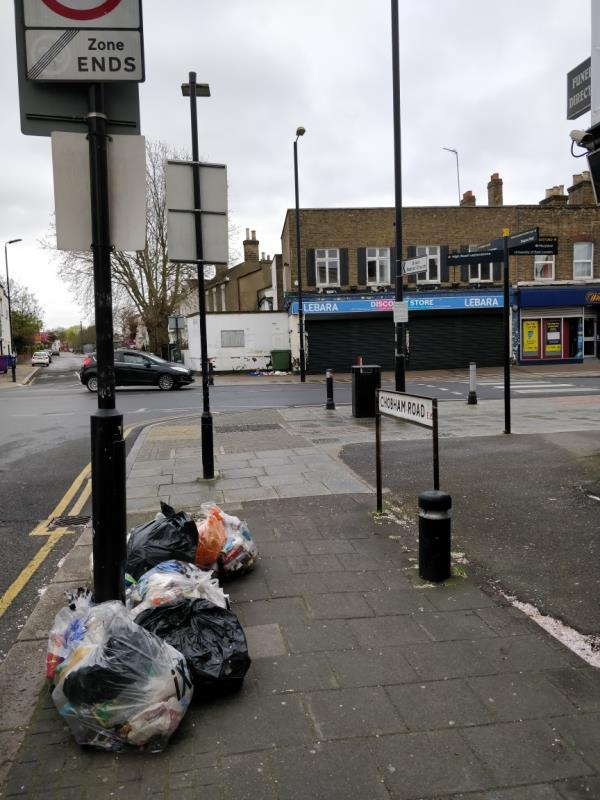 Dumped black bags of rubbish on the pavement at the corner of Chobham Road and Leytonstone Road E15-159a Leytonstone Road, London, E15 1LH