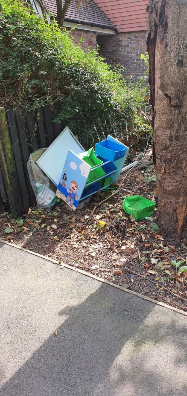 Green garden waste /branches. Black sacks in the shrubbery. Small cabinet all along Hadleigh Walk E6 image 2-8 Elmley Cl, London E6 5RZ, UK
