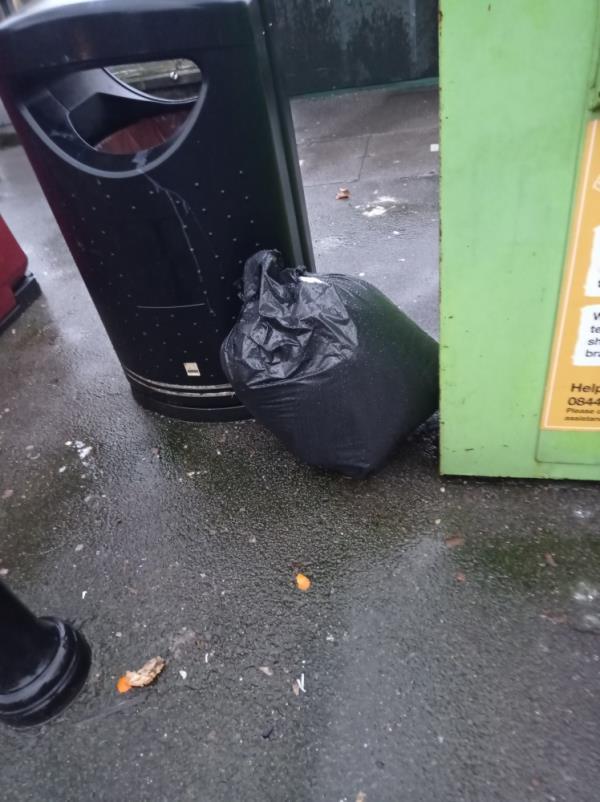 Bag of domestic rubbish near bin-44 Howard Street, Reading, RG1 7XS