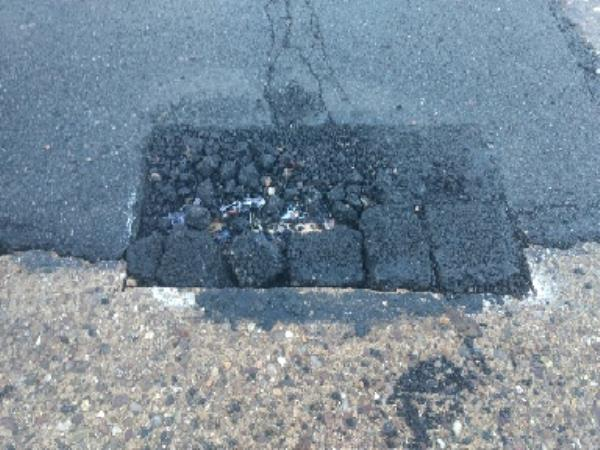 I reported the road crumbling on Lamborne road at the beginning of October. This is how it has been fixed with a now much larger crumbling hole. the buses use this route. The surface started coming apart within days and there appears to be rubbish underneath the 'new' road surface.-67 Lamborne Rd, Leicester LE2 6HQ, UK