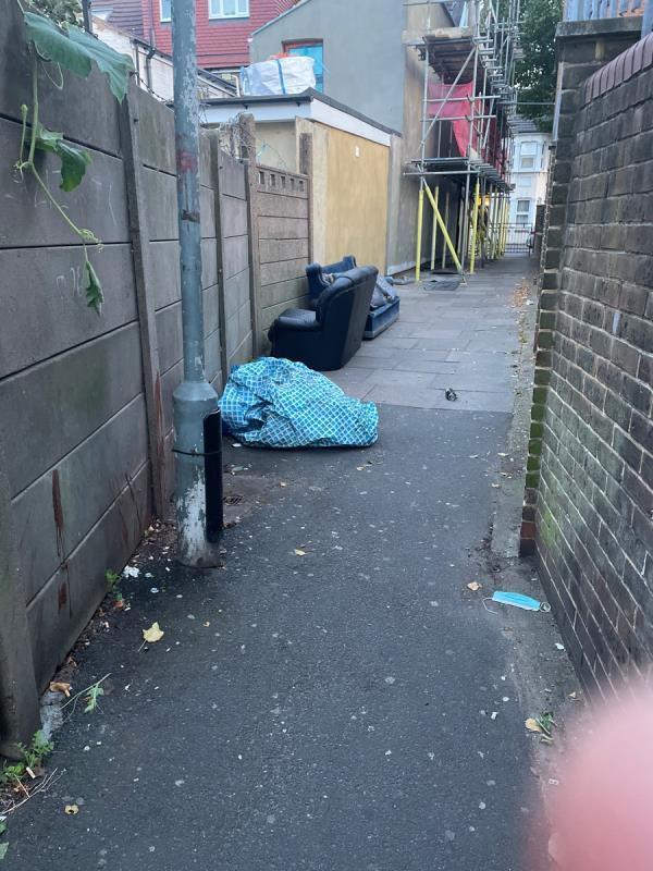 Sofa dumped in alley -121 Dorset Rd, London E7 8PX, UK