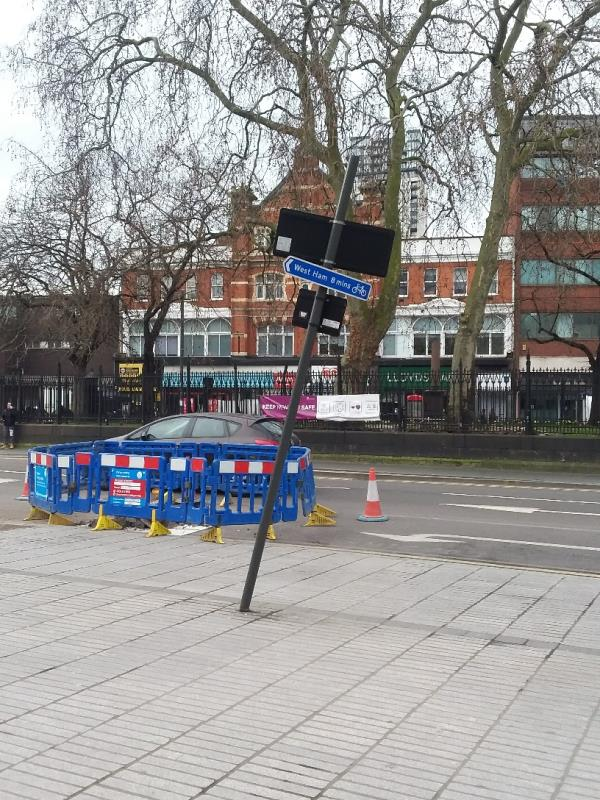 Bent roadsign at this location-43-45 Broadway, London, E15 4BQ