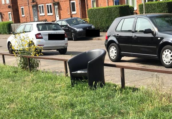 Chair dumped on the green area-21a Biddle Road, Leicester, LE3 9HJ