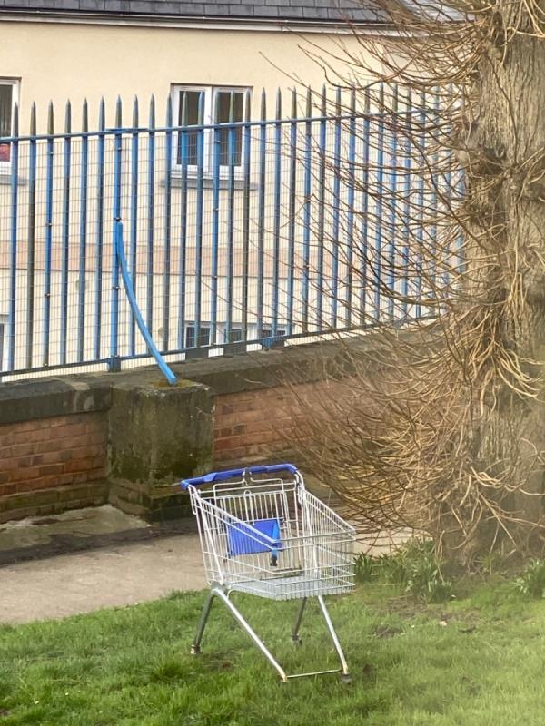 Shopping trolley dumped -10 Dragoon Ct, Aldershot GU11 1YF, UK