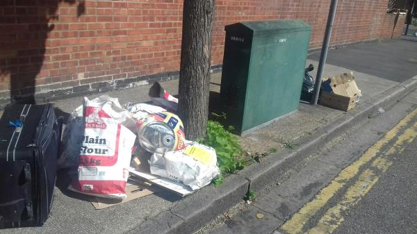 A black bag, cardboard boxes and wastes bags dumped near 203 Sixth Avenue junction with Church Road -203 Church Road, Manor Park, E12 6HB