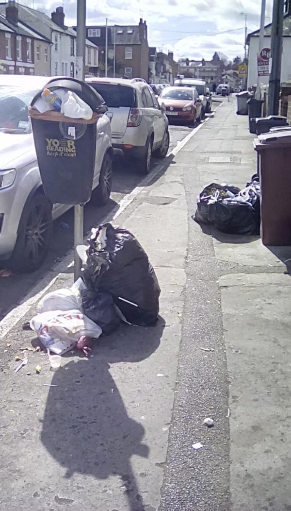 Rubbish piling up under litter bin on corner of George Street and Cambridge Street-58 George Street, Reading, RG1 7NP