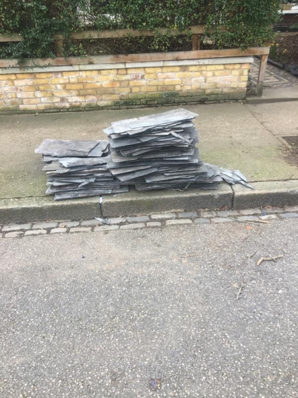 Slate dump on sidewalk -144 Hampton Road, London, E7 0NT