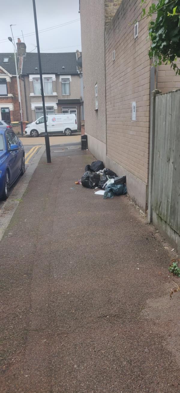 Pile of bin bags-51 Springfield Rd, London E6 2AH, UK