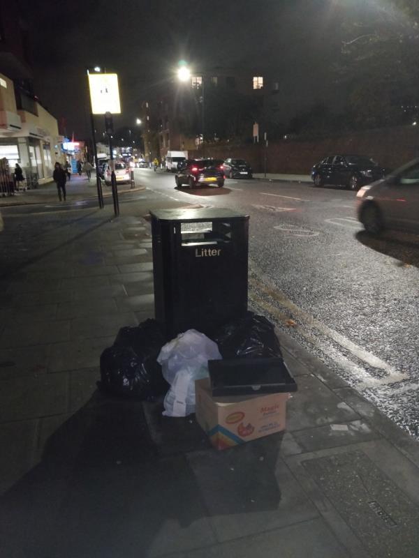 Dumped black bags of rubbish on the pavement beside 91-97 Leytonstone Road E15-89b Leytonstone Road, London, E15 1JA