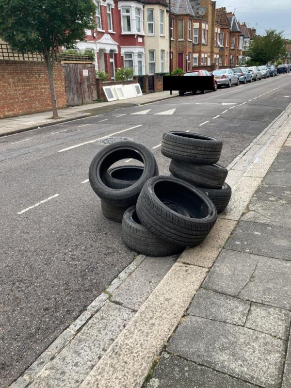 Dumped wheels and on opposite side of road, 3 doors -1 The Stables Ellenborough Road, London, N22 5EX