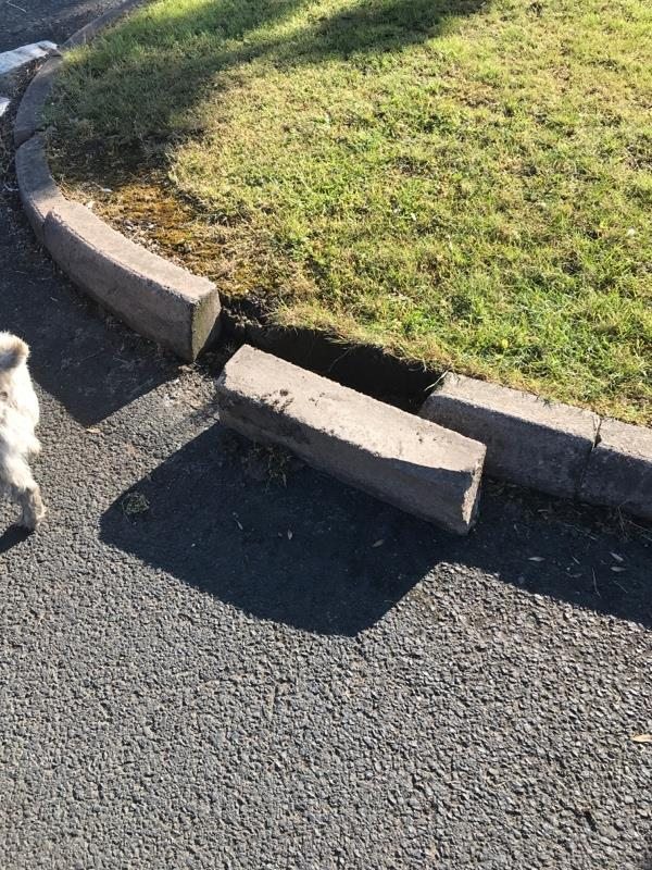 Kerb damaged end of recess road off Wood End Road/ Beech Tree Avenue-419 Wood End Rd, Wolverhampton WV11 1YE, UK