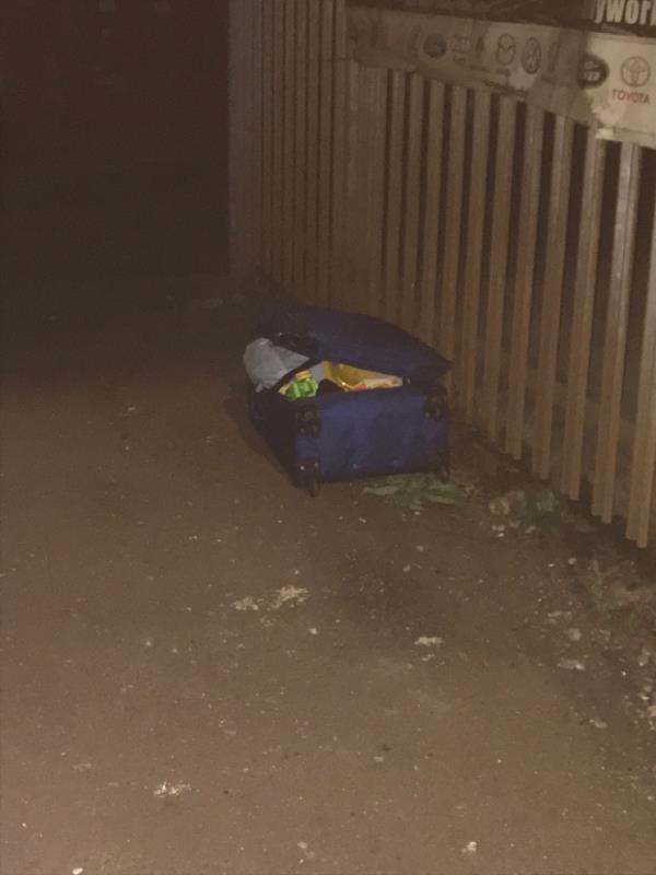 Suitcase dumped under the arches -7 Latimer Rd, London E7 0LH, UK