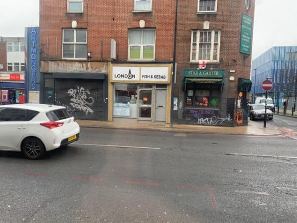 Remove graffiti from wall-490 new crosss road