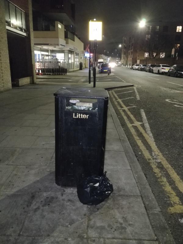 Dumped black bag of rubbish on the pavement beside Fusion Court, 91-97 Leytonstone Road E15-Fusion Court 91-97 Leytonstone Road, London, E15 1JA