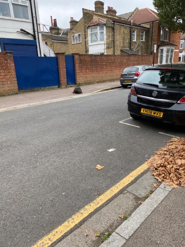 Black bag with food waste -100 Rosebery Ave, London E12 6PS, UK