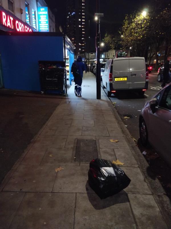 Dumped black bag of rubbish on the pavement beside 104; Leytonstone Road E15-104b Leytonstone Road, London, E15 1TQ