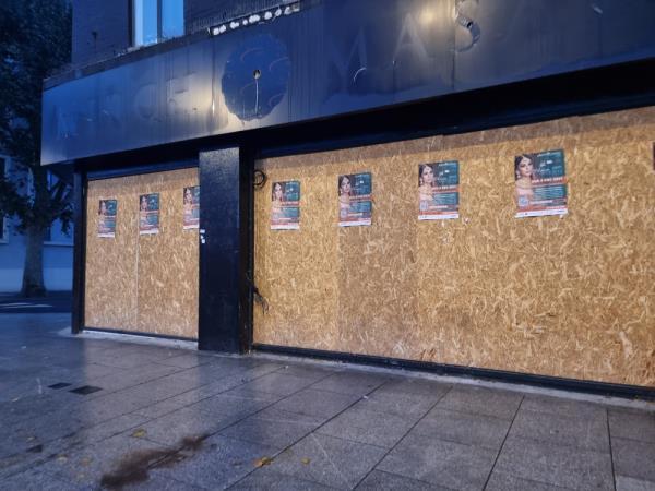 Grafitti and flypistong on hoarding area -157 Uxbridge Road The Broadway, London, UB1 1LP