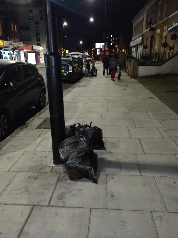 Dumped black bags of rubbish on the pavement beside 147 Leytonstone Road E15 -151 Leytonstone Road, London, E15 1LH