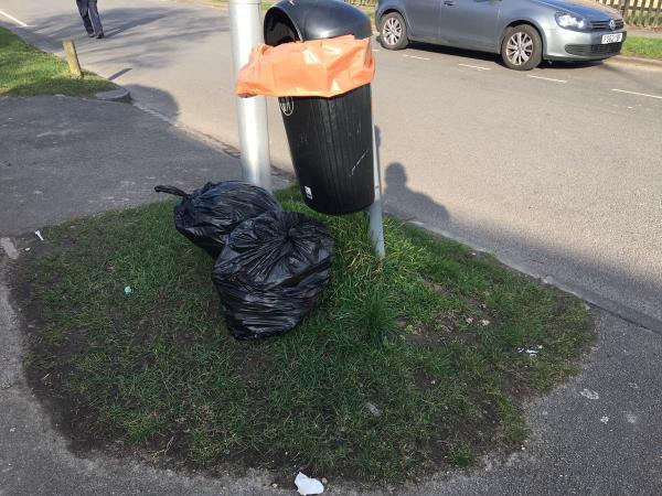Rubbish sacks dumped by bin on pavement-254 Wensley Road, Reading, RG1 6DP