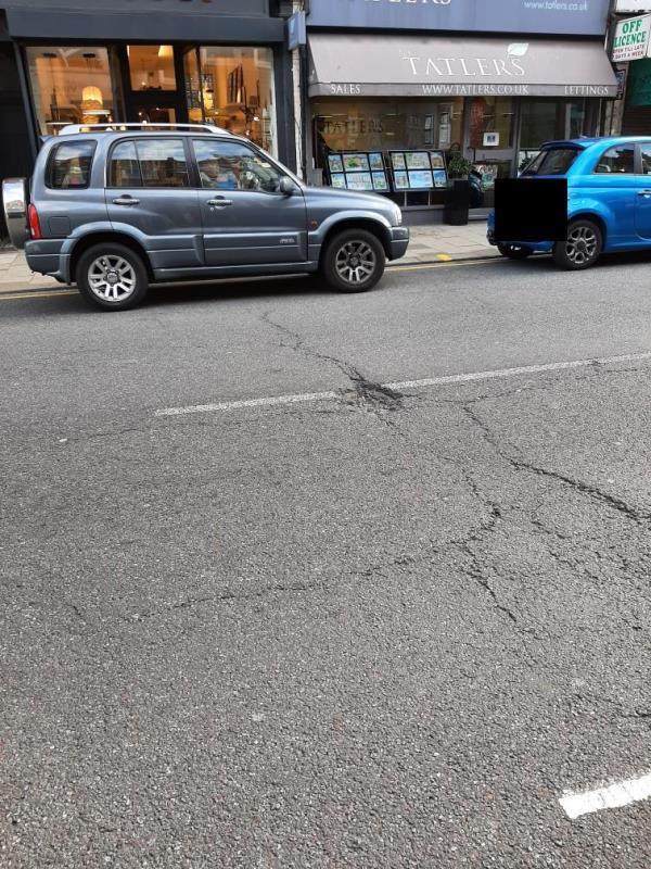 Large pothole in front of Indish shop-17 Broadway Parade, London N8 9DE, UK