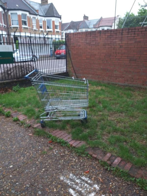 Dumped shopping trolley from IKEA at Downhills Park Road entrance to Belmont Rec. -184 Downhills Park Road, Tottenham, N17 6AP