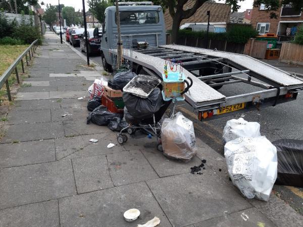 Various rubbish on Grosvenor Road close to junction with Grangewood Street -104 Grangewood Street, East Ham, E6 1HB