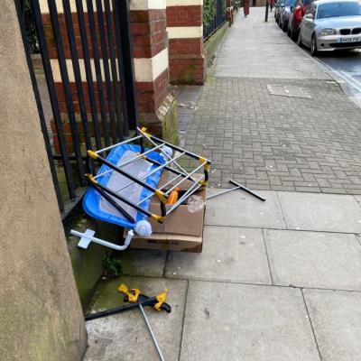 Someone damping rubbish by pavement -214 Dalston Lane, London, E8 1AS