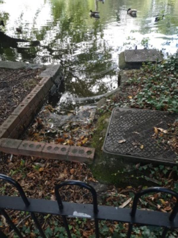 outflow of Manor Park pond is thoroughly blocked level very high-350 High Street, Aldershot, GU12 4JU